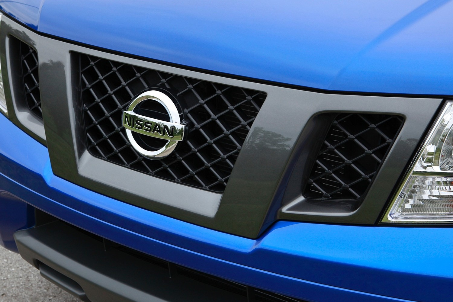 Nissan Frontier SV Extended Cab Pickup Front Badge (2013 model year shown)