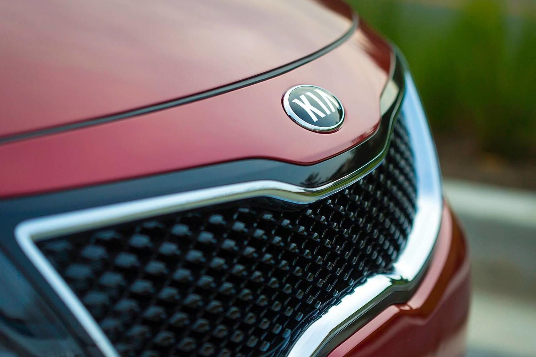 2015 Kia Optima SX Turbo Sedan Front Badge Shown