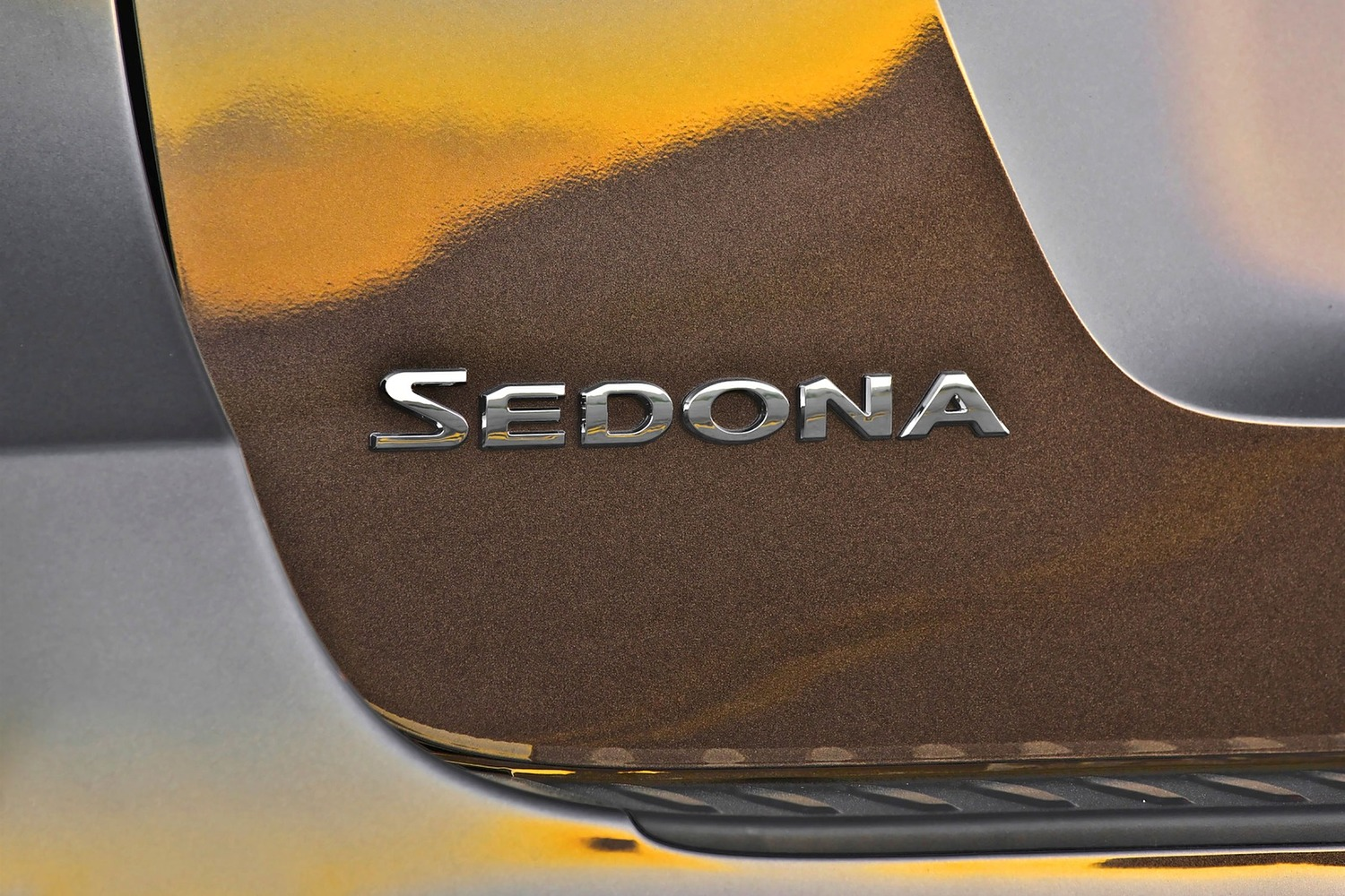 Kia Sedona SX Limited Passenger Minivan Rear Badge (2016 model year shown)